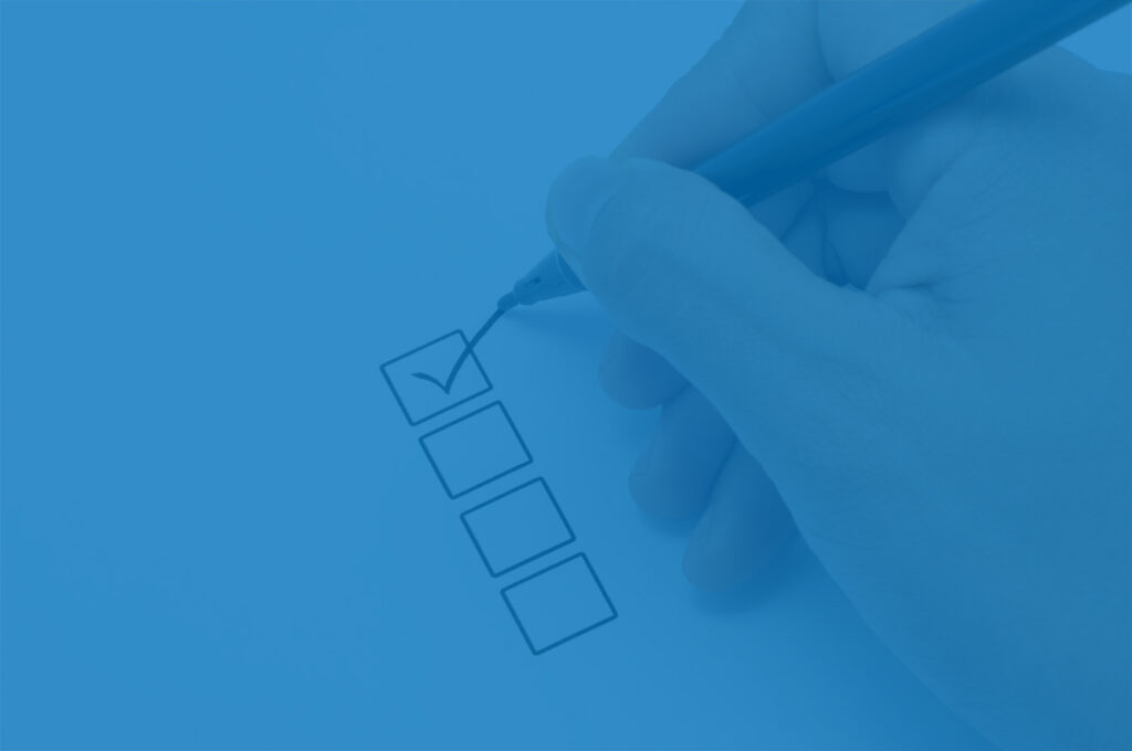 Hand filling out a checklist