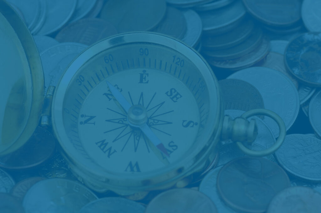 Compass in money to illustrate wealth gap and business planning concept