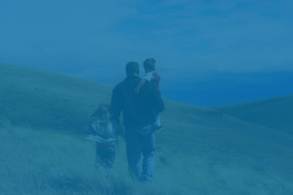 Family hiking in the hills, representing estate planning for family future.