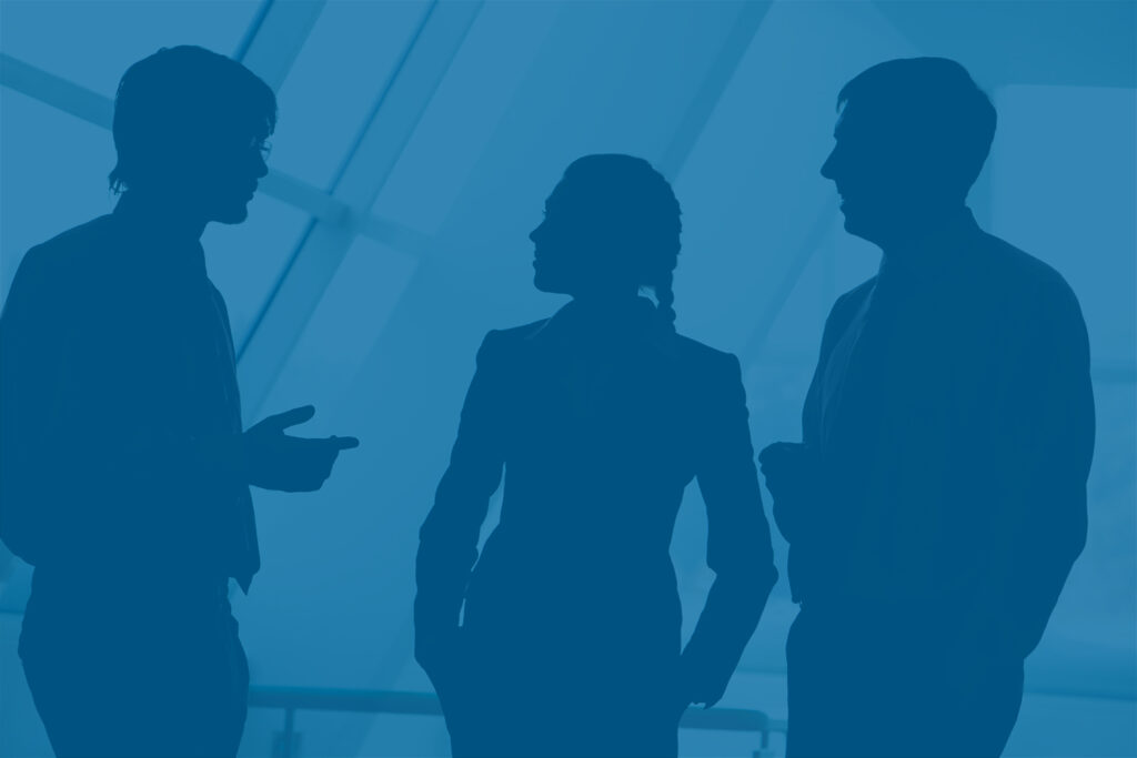 Silhouettes of business team talking - stagflation concept