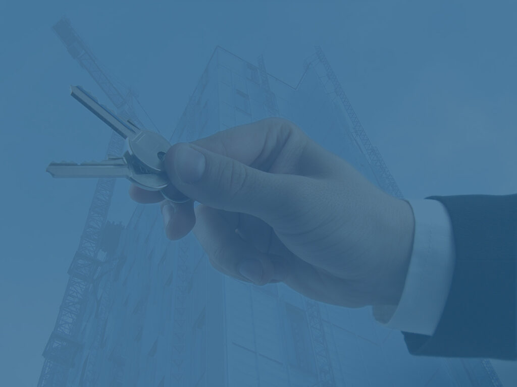 Businessman holding keys to signify business relocation