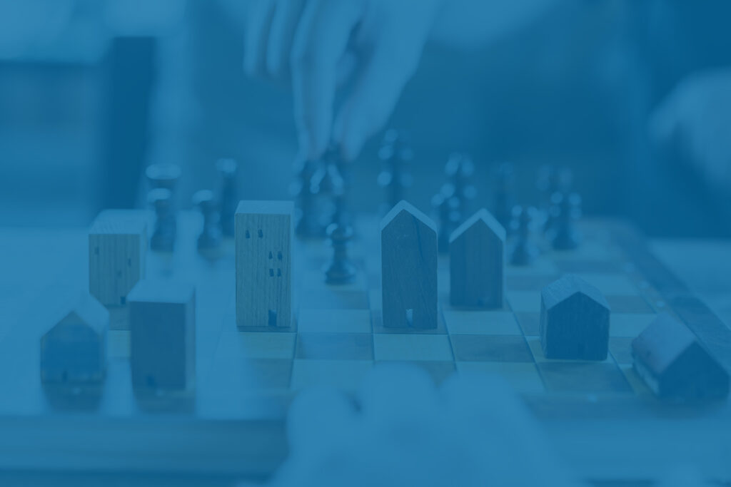 Real estate investment chess board concept