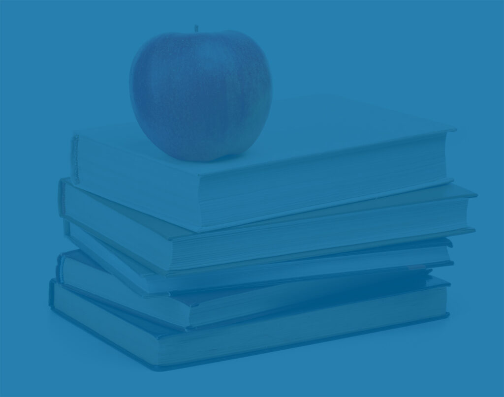 Stack of books and apple as metaphor for 529 college savings plan.