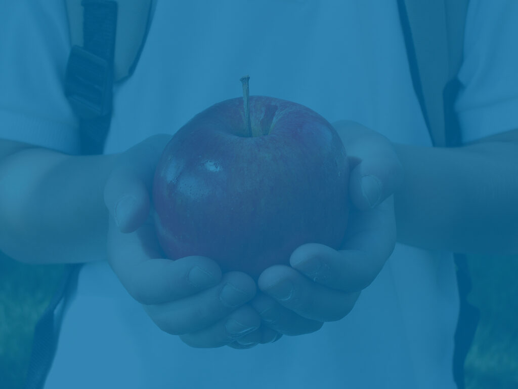 Student holding an apple - college savings metaphor
