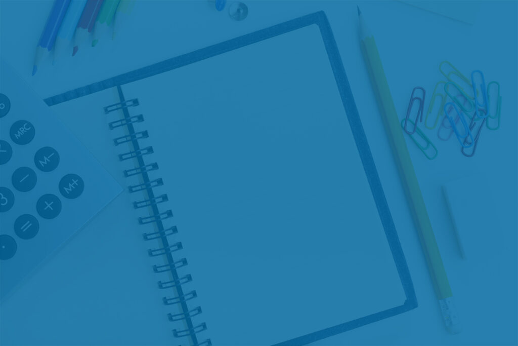 calculator, journal and office supplies for tax planning
